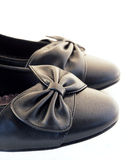 Fashion black shoes detail. Black leather female fashion shoes detail on a white background Royalty Free Stock Images
