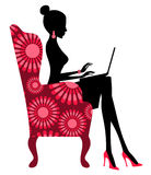 Fashion Blogger. Young fashionable woman working on  laptop Royalty Free Stock Photo