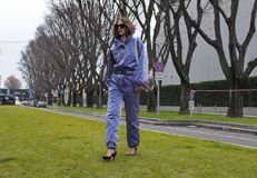 MILAN - FEBRUARY 25, 2018: Fashion blogger CANDELA PELIZZA posing for photographers in the street before Armani fashion show, duri. Fashion blogger CANDELA royalty free stock photos