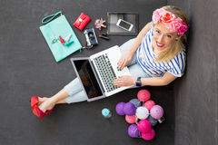 Fashion blogger with computer looking up stock photo