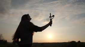 A fashion blogger girl shoots a selfie video vlog on a smartphone in slow motion. A fashion blogger girl shoots a selfie video vlog on a smartphone with a stock video