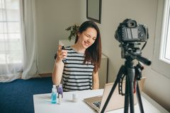 A fashion blogger records the video stock image