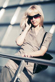 Fashion blond business woman calling on cell phone Royalty Free Stock Images
