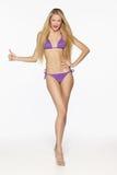 Fashion blond female in lilac bikini Stock Images