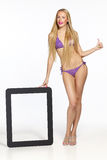 Fashion blond female in lilac bikini Stock Photo