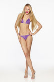 Fashion blond female in lilac bikini Stock Photos