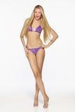 Fashion blond female in lilac bikini Stock Photos
