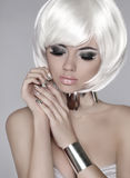 Fashion blond girl. Beautiful face of glamour woman with smoky e Stock Photography
