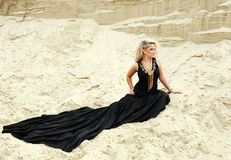 Fashion blond girl in long black dress Stock Photo