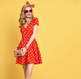 Fashion Blond Girl in Red Polka Dots Dress. Outfit Royalty Free Stock Photo