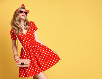 Fashion Blond Girl in Red Polka Dots Dress. Outfit Stock Image