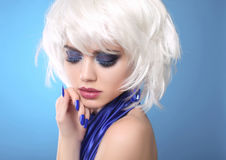 Fashion Blond Girl. White Short Hair. Beauty makeup Portrait Woman. Blue manicured nails. Face Close up. Hairstyle. Fringe. Vogue Style royalty free stock photography