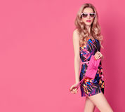 Fashion Blond Model in Summer Jumpsuit on Pink Royalty Free Stock Images