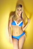Fashion blond model wearing blue bikini Royalty Free Stock Photo