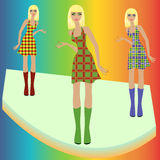 Fashion blond models posing on podium in checkered Stock Image