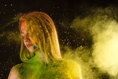 Fashion blond woman in colors Holi Stock Photos