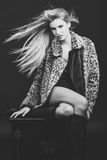Fashion blond woman with flying hair wearing fur jacket Stock Images