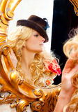 Fashion blond woman with hat in mirror Stock Photo
