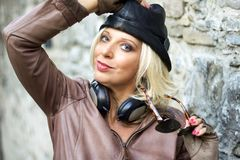 Fashion  woman with headphones and black hat Royalty Free Stock Photography
