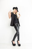 Fashion Blond Woman Portrait in black hat Royalty Free Stock Images