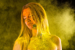 Fashion blond woman in yellow colors Holi Royalty Free Stock Photo
