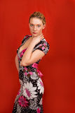 Fashion blonde. Standing with hand lifted and looking appear royalty free stock photography