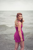 Fashion blonde at the beach sea side posing in water Stock Photo