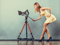 Fashion blonde girl with camera Stock Photography