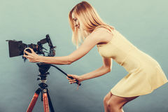 Fashion blonde girl with camera Stock Photos