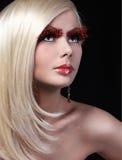 Fashion Blonde Model with Long Orange Eyelashes. P Royalty Free Stock Photo