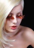 Fashion Blonde Model with Long Orange Eyelashes. Royalty Free Stock Photo