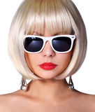 Fashion Blonde Model with Sunglasses. Glamorous young woman. With short bob hairstyle isolated on white. Vogue Style Girl. Haircut Royalty Free Stock Photography