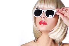 Fashion Blonde with Sunglasses. Glamorous young woman with short bob hairstyle isolated on white. Vogue Style Girl. Haircut Stock Image