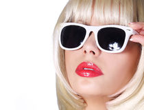 Fashion Blonde with Sunglasses. Glamorous young woman with short bob hairstyle isolated on white. Vogue Style Girl. Haircut Royalty Free Stock Image