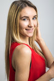 Fashion Blonde Woman In Red Dress In The Studio. Royalty Free Stock Images