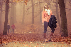 Fashion blonde woman with jacket in autumn park. Stock Images