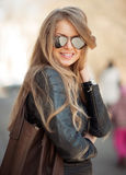 Fashion blonde woman in sunglasses - outdoor portrait Royalty Free Stock Images