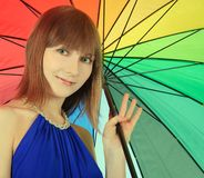 Fashion blondie posing with color umbrella Royalty Free Stock Photo