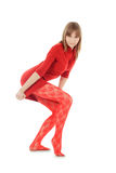 Fashion blondie in red dress posing over white Royalty Free Stock Images