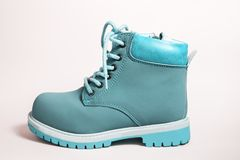 Fashion blue boots over white. Kid`s fashion blue boots over white Royalty Free Stock Image