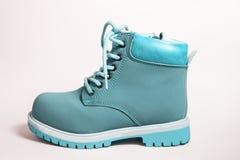 Fashion blue boots over white. Kid`s fashion blue boots over white Stock Photography