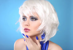 Fashion Bob Blond Girl. White Short Hair. Beauty makeup Portrait. Woman. Blue manicured nails. Face Close up. Hairstyle. Fringe. Vogue Style royalty free stock photos