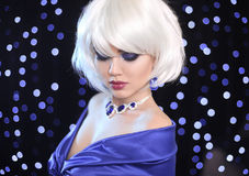 Fashion Bob Blond Girl. White Short Hair. Beauty makeup Portrait. Woman. Gems jewelry pendant. Face Close up. Hairstyle. Fringe. Vogue Style royalty free stock photography