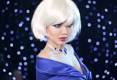 Fashion Bob Blond Girl. White Short Hair. Beauty makeup Portrait. Woman. Gems jewelry pendant. Face Close up. Hairstyle. Fringe. Vogue Style Stock Image