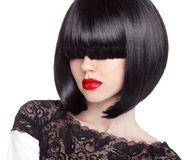 Fashion bob Haircut. Hairstyle. Long Fringe. Short Hair Style. B. Runette girl with red lips isolated on white background Stock Photo