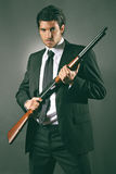 Fashion bodyguard poses with shotgun Royalty Free Stock Photography