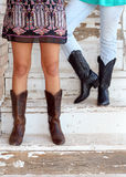 Fashion Boots on Teenage Girls. Two fashionable girls wearing boots stock photography
