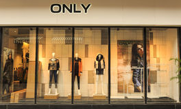 Fashion boutique display window with mannequins, store sale window, front of shop window Stock Image