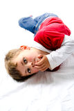 Fashion boy. Young boy laying on white background looking at camera Stock Photo