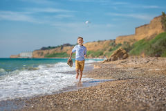 Fashion boy on the beach Stock Images
